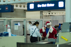 Even Santa has to submit to the TSA (Mark Demeny) Tags: santa leica chicago airport security tsa m8 leicam8 voigtlandernokton40mmf14mc