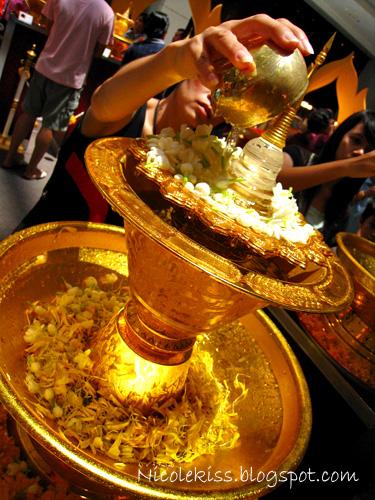 praying and pouring water - songkran