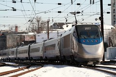 Acela - Baltimore, MD (Laurence's Pictures) Tags: new york railroad travel snow philadelphia boston speed train design dc washington high photographer united nazi corridor fast police rail baltimore passengers amtrak rights service express passenger disturbing states curved higher northeast without privacy abuse forces tgv arrest highspeed nec speeds acela tilting catenary lowering lateral centrifugal northeastcorridor allows 2037 highspeedrail sharply pantagraph banked accela acella