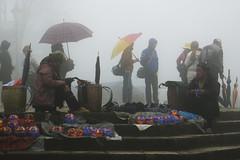 Black Hmong Women at Sa Pa Market (чãvìnkωhỉtз) Tags: mist misty fog lumix haze raw market hats streetphotography vietnam umbrellas sapa hmong laocai blackhmong ethnicminority 2011 việtnam lx5 sapatown làocai dântộc hmông hmôngđen gavinkwhite