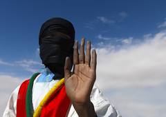 Veiled Tuareg man waving to the camera, Libyan desert (Eric Lafforgue) Tags: sky hand desert culture tribal tribes tradition tribe ethnic libya tribo tuareg ethnology tribu libia libye libyen ghadafi lbia 13841 lafforgue ethnie libi libiya  ribia liviya khadafi libija   tourageg     lbija  lby  libja lbya liiba livi