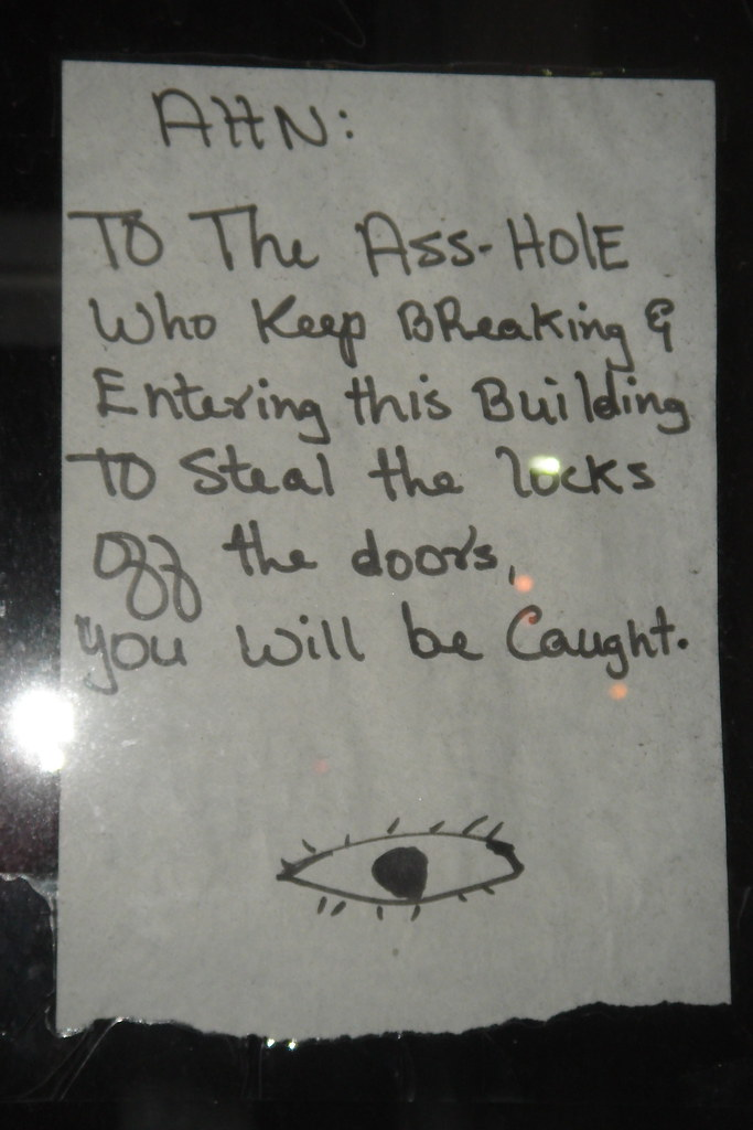 Attn: To the Ass-hole who keeps breaking & entering this building to steal the locks off the doors, you will be caught.
