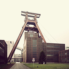 Industrial world heritage (manganite) Tags: world windows red sky panorama color green heritage texture monument glass architecture clouds digital buildings germany square geotagged construction essen nikon europe mine industrial mood pattern tl steel bricks perspective atmosphere unesco stitching bauhaus desaturated d200 coal nikkor dslr toned frderturm zollverein zeche headgear 50mmf18 northrhinewestphalia 500x500 katernberg utatafeature manganite nikonstunninggallery date:year=2007 date:month=december geo:lat=51486307 geo:lon=7045171 date:day=23 format:orientation=square format:ratio=11