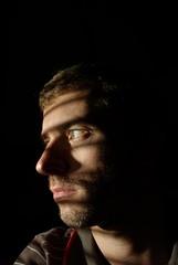 On the lookout (Brett Dickson) Tags: portrait selfportrait flash blinds wireless lowkey filmnoir stubble achiever hardlight srobist achievertz250