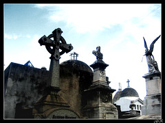 City of Angels III (LordGK) Tags: light sky color graveyard statue clouds contrast buenosaires cross cementerio tomb recoleta melancholy
