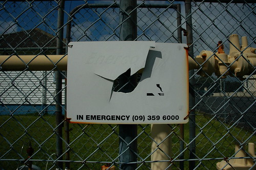 Broken sign 'IN EMERGENCY' (WS)