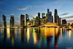 The CBD of Singapore. (Reggie Wan) Tags: sunset urban reflection building tourism skyline evening singapore asia southeastasia cityscape cbd bluehour marinabay singaporeskyline asiancity citynightlight sonya700 sonyalpha700 panoramafotogrfico reggiewan