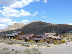 Ghost Town of Bodie (RuthannOC) Tags: california ca city sun building mill abandoned car clouds contrast gold town cowboy village nevada ghost sierra rush strong bodie wreck destroyed ruthann