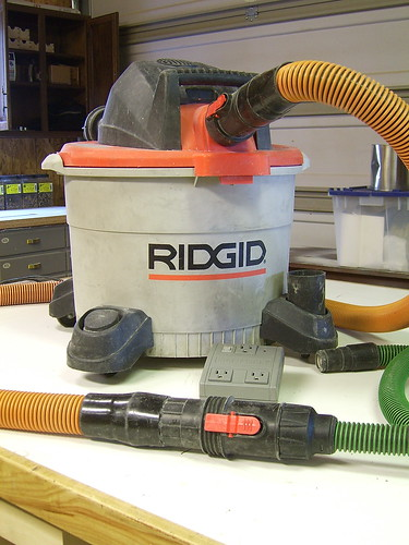 Shop vac with various hose connections.