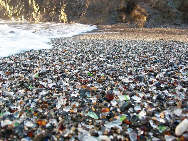 Close-up view of the colored glass beads mixed in the sand at Glass Beach near Fort Bragg, CA - glassbeach36x
