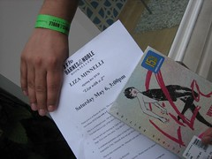 Showing off one of the prized wristbands and written instruction sheets. (05/06/2006)