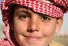 Smilng in the Sun (hazy jenius) Tags: travel boy smile kids scarf children headscarf middleeast backpacking journey syria palmyra bedouin tadmoor keffeya tadmour
