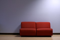 red sofa (xgray) Tags: blue light shadow red wall digital upload 35mm canon austin eos prime blog university texas universityoftexas sofa iphoto blogged utc newpaint ef35mmf2 photographeroftheweek 40d adidap universityteachingcenter postedtophotographersonlj creativecomments alldayidreamaboutphotography xgv08