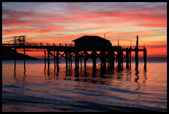 Totland Pier Twilight, Isle of Wight (s0ulsurfing) Tags: ocean light sunset shadow red sea sky cloud sun sunlight holiday seascape black color colour reflection tourism beach nature water beautiful weather silhouette clouds wow reflections island evening bay coast pier twilight holidays skies colours sundown natural dusk patterns sightseeing shoreline silhouettes tourist romance canvas wash coastal shore vectis isleofwight coastline ripples february 2008 isle soe sights wight attraction totland wavelets eow idylic canvasart totlandbay s0ulsurfing visitorattraction abigfave canvasprints totlandpier superbmasterpiece isleofwightattractions isleofwightattraction gicleecanvasprints welcomeuk