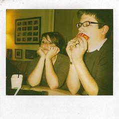 We played Appples to Apples.  Don't they look like they are having fun (elizabeth frances) Tags: game polaroid cards buffalo spectra gregkamprath savepolaroid kellykamprath
