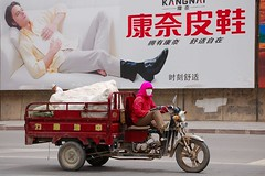 on the road... (Maggie's World ...) Tags: tricycle inner advertisement mongolia ontheroad toughlife ladydriver alashanzuoqi bayanhot