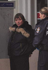 An older woman is arrested outside 411 Seniors Centre