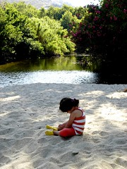 THE RIVER AT THE BEACH (dimitra_milaiou) Tags: life shadow summer people beach nature water girl reflections river landscape island greek grey one 1 sand europe paradise village child stripes sony small hellas greece planet summertime emotions andros cyclades katerina dimitra dscp93a  stenies gyalia      steniaes milaiou