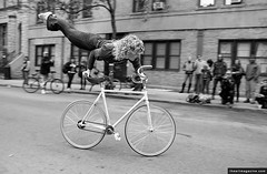 Bicycle Film Festival, New York City, NY (iheartmagazine) Tags: street nyc newyorkcity blackandwhite bw eastvillage ny girl bike outside outdoors manhattan sunny tricks acrobat biker daytime fixie fixedgear trick performer stunt bff 2007 trackbike bicyclefilmfestival
