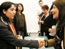 Malalai Joya (left) is shaking hands with an audience member