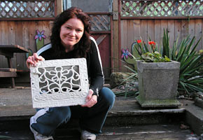 Michelle Monforton with one of the grates she took from her old home. The plant pot (r.) is made of the house's chimney.