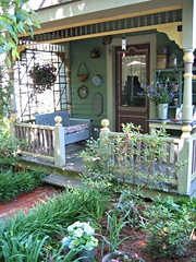 Cecile's Garden (Pandorea...) Tags: blue yellow good alabama porch spindles feng delightful victorianarchitecture perennials shui cottagegarden mgtour2005 passalongplants
