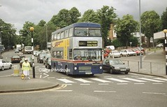 Crossing the crossing at the Green. (Lady Wulfrun) Tags: road 2001 travel west green june birmingham scene busy 2403 midlands wawrick a41 metrobus mki acocks
