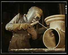 Welder making boilers for a ship, Combustion E...
