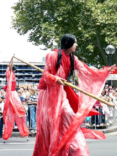 Cross-Dressing Stilt Walkers