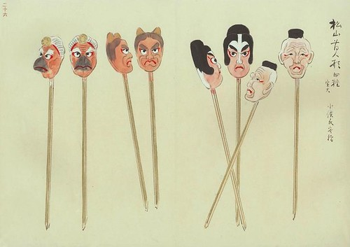 angry toy heads on sticks