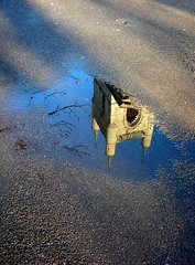 puddle-gazing (overthemoon) Tags: reflection puddle switzerland interestingness upsidedown sunny explore vevey flaque vaud stmartinschurch romandie gouille genevalunch fortifiedtower mywinners avision uisforupsidedown bestofr swisspeeks3 abcsphotooftheweekapril08