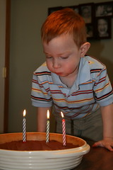 Blowing out the candles, trying anyway
