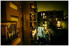 Noches reversibles (Ibai Acevedo) Tags: city light shadow building luz window night ventana noche town smoke edificio pueblo ciudad sombra fumar masnou templanciaperseverancia