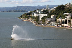 Oriental Bay fountain, Wellington (chris.bryant) Tags: ocean sea newzealand summer sky sun nature water fountain clouds buildings landscape day afternoon harbour hills wellington northisland 1001nights soe orientalbay gmt movingwater blueribbonwinner 5photosaday abigfave anawesomeshot amazingamateur theunforgettablepictures overtheexcellence thebestofday gnneniyisi naturallyartificial qualitypixels vanagram guasdivinas aguasdivinas panoramafotogrfico