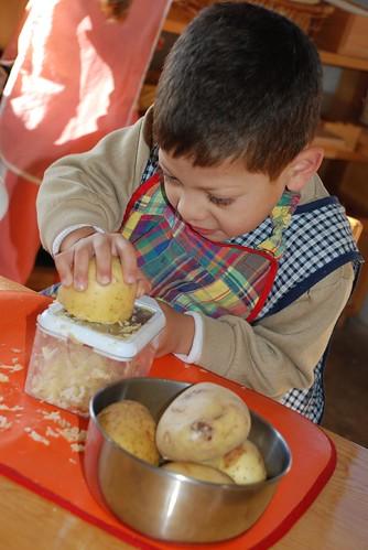 hanukkah - grating potatoes for latkes