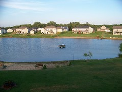 Man-made lake / pond in an Allendale subdivision (Will S.) Tags: houses usa lake america us pond unitedstates michigan unitedstatesofamerica lakes suburbia suburbs raft theunitedstatesofamerica ponds mypics rafts freshwater allendale westmichigan westernmichigan manmadelake manmadepond theunitedstates artificiallake manmadelakes manicuredlawns artificiallakes grandrapidsarea artificialpond manmadeponds artificialponds unitedstatesofaamerica