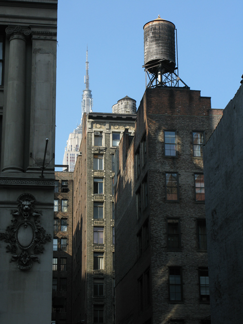 several water towers and a glimpse of the Empire State Building, Manhattan, NYC