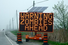 Time Of The Season (flipkeat) Tags: road signs ontario canada halloween sign warning real outdoors weird crazy scary funny published photos zombie walk unique freaky canadian odd signage annual milton zombies ripleysbelieveitornot humourous believeitornot zombiewalk bizare 2013 funnyroadsign dslra500 youveneverseenthisbefore