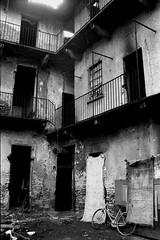 Clandestine life I (About a Majordomo) Tags: life bw white black decay hp5 3200 bianco ilford nero vita clandestine arrangiarsi abbandoned clandestino abbandono sofferenza bnvitadistrada bnperiferia bnreportage clandestineness