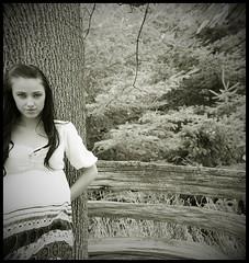 a fishies eye (monsters.monsters) Tags: trees shadow portrait blackandwhite bw woman distortion selfportrait tree girl female hair lens woods nikon angle wide longhair blouse fisheye bark smirk leaning pinetrees woodfence d80