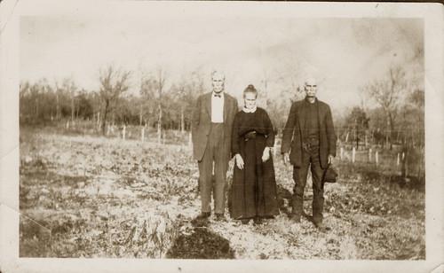 Two men one woman in a field