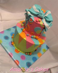 Bauman Birthday Cake (mandotts) Tags: pink orange green bright teal circles polkadots birthdaycake wonky topsyturvy 2tier fondantbow fondantbright