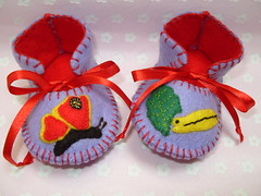 lavender and red handmade baby booties with a caterpillar transforming into a butterflly (Funky Shapes) Tags: uk flowers baby love colors animals kids shoes autum handmade insects felt zapatos yarn gift booties bebes babygift handstich funkyshapes babyclothing babyslippers etsybaby