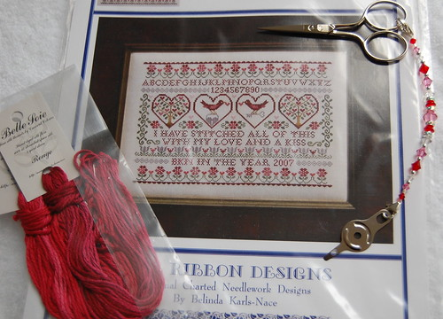 "Blue Ribbon Designs ""Stitched With Love."""