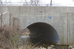 Stone arch bridge over Hollow Road Creek