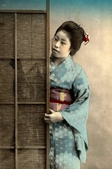 TAKING A PEEK -- A Pretty Geisha Watching a Young Man Visiting in the Next Room
