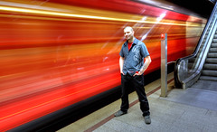 2 seconds in Paddy's life (Toni_V) Tags: longexposure red motion blur station tattoo reflections movement paddy tripod escalator 2550fav zürich 2008 gitzo d300 sigma1020mm selnau tthdr hdrsingleraw capturenx toniv 5for2 gt1540 ©toniv sundaymorningphototour photomatix30 swisspeeks3 phototouroninlineskates