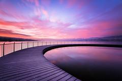 The Circle (pixadeleon) Tags: langzeitbelichtung zürichsee tiefenbrunnen pink rosa steg longexposure lake zurich pier bath clouds water kreisel circle