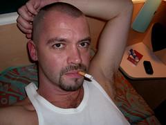 man 024-1 (SkinHH) Tags: gay feet goatee skin smoking hairylegs skinhead