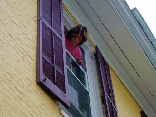 Denise Washing Windows on the Third Floor